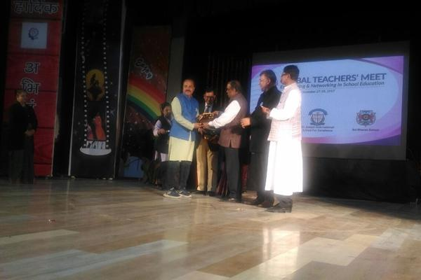 Sh. Dinesh Sharma (PGT, Mathematics) awarded for successful completion of 20 years in education field Organised by Global Teachers Meet held at Campion School Auditorium.