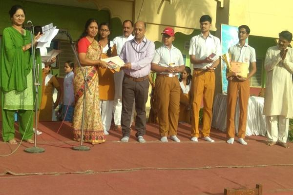 Smt. Nisha Verma (PGT, Commerce) awarded best coordinator by WIZ Spell Bee held at IES Public School, Bhopal.