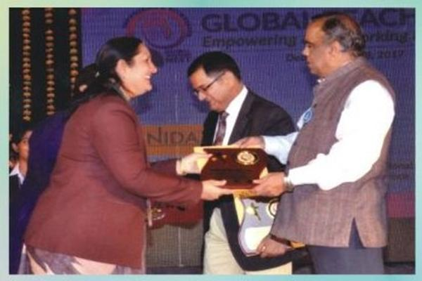 Smt. Seema Sarkar (PGT, Biology) awarded for successful completion of 20 years in education field Organised by Global Teachers Meet held at Campion School Auditorium.